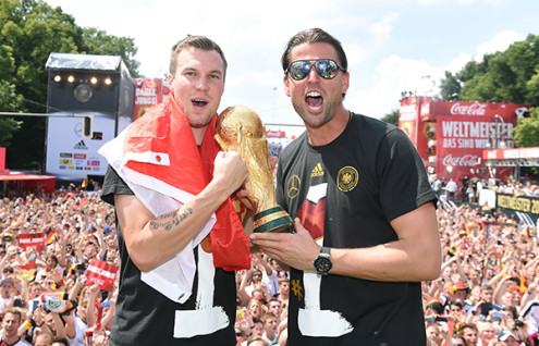 BERLIN, GERMANY - JULY 15:  Kevin Grosskreutz and Roman Weidenfeller celebrate during the German team victory ceremony on July 15, 2014 in Berlin, Germany. Germany won the 2014 FIFA World Cup Brazil match against Argentina in Rio de Janeiro on July 13.  (Photo by Markus Gilliar - Pool /Getty Images)